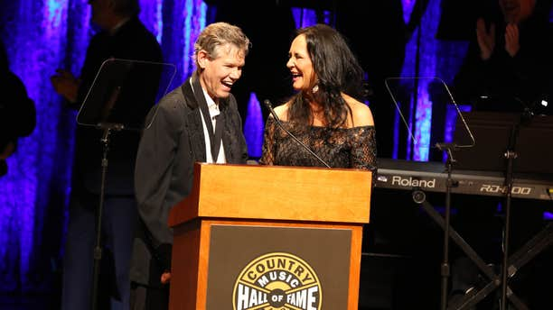 From left, artist Randy Travis and wife Mary Travis as the Country Music Hall of Fame Medallion Ceremony at the Country Music Hall of Fame and Museum on Sunday, Oct. 16, 2016 in Nashville, Tenn.