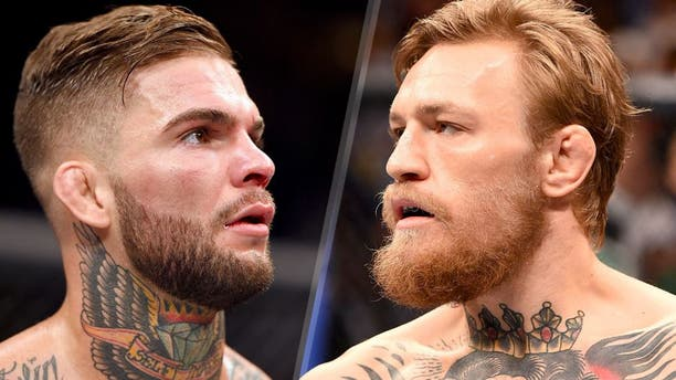 LAS VEGAS, NV - JULY 11: Cody Garbrandt awaits the final decison in his bantamweight fight during the UFC 189 event inside MGM Grand Garden Arena on July 11, 2015 in Las Vegas, Nevada. (Photo by Josh Hedges/Zuffa LLC/Zuffa LLC via Getty Images) LAS VEGAS, NV - JULY 11: Conor McGregor prepares to faces Chad Mendes in their UFC interim featherweight title fight during the UFC 189 event inside MGM Grand Garden Arena on July 11, 2015 in Las Vegas, Nevada. (Photo by Josh Hedges/Zuffa LLC/Zuffa LLC via Getty Images)