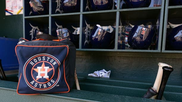 DETROIT, MI - MAY 23: A detailed view of a Houston Astros equipment bag and batting helmets in the dugout prior to the game against the Detroit Tigers at Comerica Park on May 23, 2015 in Detroit, Michigan. The Astros defeated the Tigers 3-2. (Photo by Mark Cunningham/MLB Photos via Getty Images)