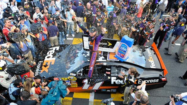 Oct. 24: Denny Hamlin celebrates after winning the NASCAR Sprint Cup Series auto race at Martinsville Speedway in Martinsville, Va.