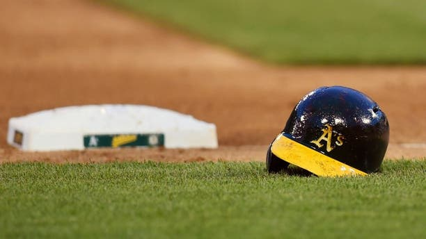 OAKLAND, CA - MAY 10: The batting helmet belonging to Josh Reddick #16 of the Oakland Athletics sets on the field during a Major League Baseball game against the Washington Nationals at O.co Coliseum on May 10, 2014 in Oakland, California. (Photo by Thearon W. Henderson/Getty Images)