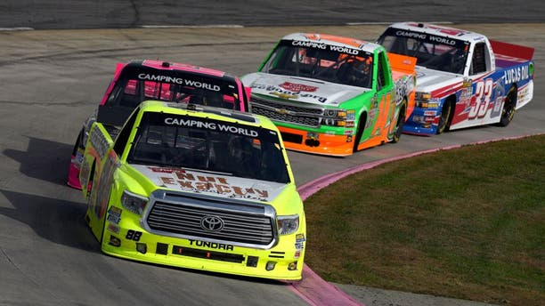 MARTINSVILLE, VA - OCTOBER 31: Matt Crafton, driver of the #88 Fisher Nuts/Menards Toyota, leads a pack of trucks during the NASCAR Camping World Truck Series Kroger 200 at Martinsville Speedway on October 31, 2015 in Martinsville, Virginia. (Photo by Jonathan Moore/Getty Images)