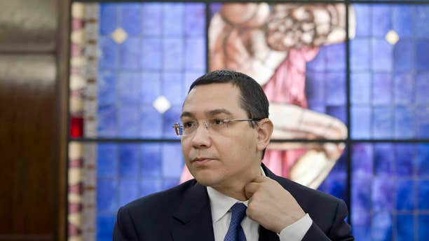 June 9, 2015:  Romanian Prime Minister, Victor Ponta, adjusts his collar during a meeting with foreign media at the government headquarters in Bucharest.