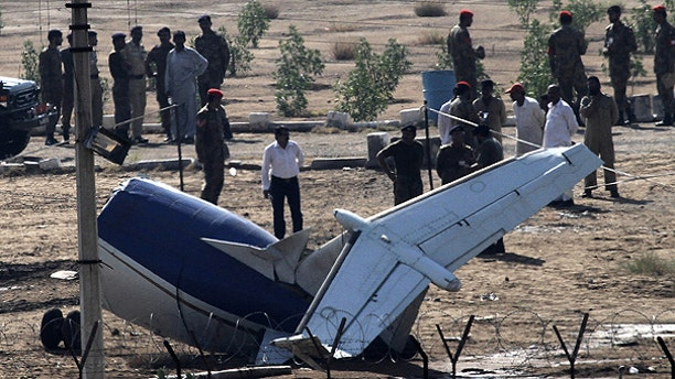 Nov. 5: Pakistani officials and soldiers examine the site of a plane crash in Karachi, Pakistan.