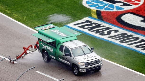 FORT WORTH, TX - APRIL 06: A view of an Air Titan on track as rain falls prior to the NASCAR Sprint Cup Series Duck Commander 500 at Texas Motor Speedway on April 6, 2014 in Fort Worth, Texas. (Photo by Sean Gardner/NASCAR via Getty Images)