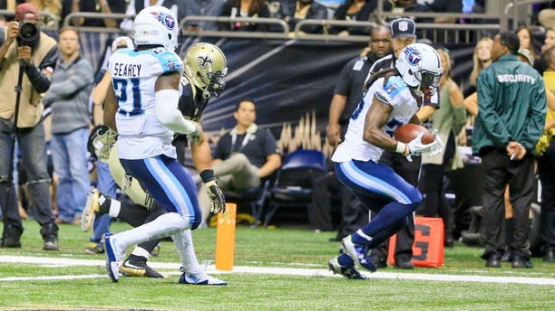 Nov 8, 2015; New Orleans, LA, USA; Tennessee Titans cornerback B.W. Webb intercepts a pass in the endzone against the New Orleans Saints during the second half of a game at the Mercedes-Benz Superdome. The Titans defeated the Saints 34-28 in overtime. Mandatory Credit: Derick E. Hingle-USA TODAY Sports