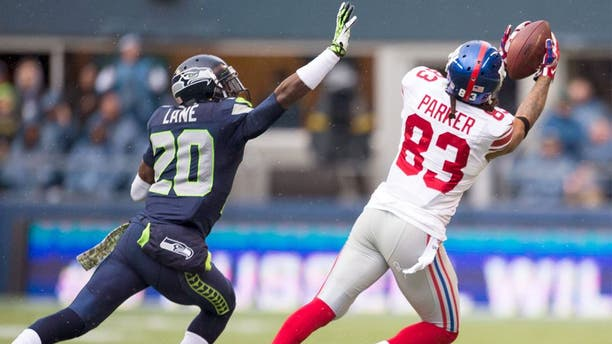 Nov 9, 2014; Seattle, WA, USA; New York Giants wide receiver Preston Parker (83) catches a pass over Seattle Seahawks cornerback Jeremy Lane (20) during the first half at CenturyLink Field. Seattle defeated New York 38-17. Mandatory Credit: Steven Bisig-USA TODAY Sports