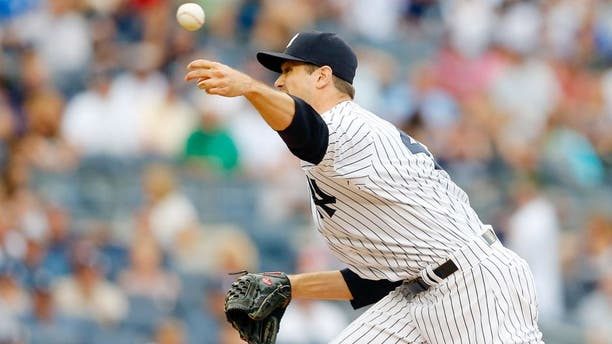 NEW YORK, NY - SEPTEMBER 12: Andrew Miller #48 of the New York Yankees in action against the Toronto Blue Jays at Yankee Stadium on September 12, 2015 in the Bronx borough of New York City. The Jays defeated the Yankees 9-5 after eleven innings. (Photo by Jim McIsaac/Getty Images)