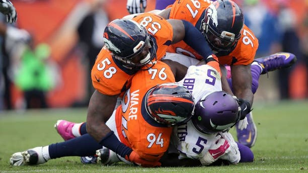 DENVER, CO - OCTOBER 04: Outside linebacker Von Miller #58, outside linebacker DeMarcus Ware #94 and defensive end Malik Jackson #97 of the Denver Broncos gang tackle quarterback Teddy Bridgewater #5 of the Minnesota Vikings at Sports Authority Field at Mile High on October 4, 2015 in Denver, Colorado. The Broncos defeated the Vikings 23-20. (Photo by Doug Pensinger/Getty Images)