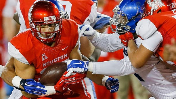HOUSTON, TX - NOVEMBER 14: Kenneth Farrow #35 of the Houston Cougars is tackled by the Memphis Tigers in the second quarter on November 14, 2015 in Houston, Texas. (Photo by Bob Levey/Getty Images)
