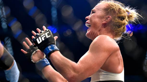 Nov. 15, 2015: Holly Holm celebrates after defeating Ronda Rousey during their UFC 193 bantamweight title fight in Melbourne, Australia