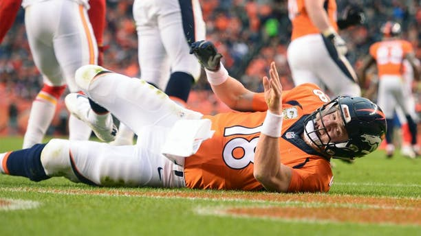 DENVER, CO - NOVEMBER 15: Peyton Manning (18) of the Denver Broncos is knocked down by Justin Houston (50) of the Kansas City Chiefs in the third quarter. The Broncos played the Kansas City Chiefs at Sports Authority Field at Mile High in Denver, CO on November 15, 2015. (Photo by Aaron Ontiveroz/The Denver Post via Getty Images)