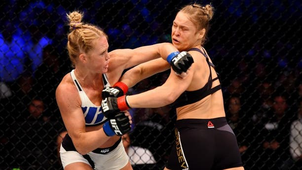 MELBOURNE, AUSTRALIA - NOVEMBER 15: Holly Holm (L) throws a left-handed punch against Ronda Rousey (R) in the first round of their UFC women's bantamweight championship bout during the UFC 193 event at Etihad Stadium on November 15, 2015 in Melbourne, Australia. (Photo by Josh Hedges/Zuffa LLC/Zuffa LLC via Getty Images)