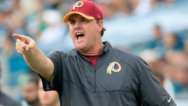 PHILADELPHIA, PA - SEPTEMBER 21: Head coach Jay Gruden of the Washington Redskins points to an officail during the second half against the Philadelphia Eagles at Lincoln Financial Field on September 21, 2014 in Philadelphia, Pennsylvania. The Eagles won 37-34. (Photo by Rob Carr/Getty Images)