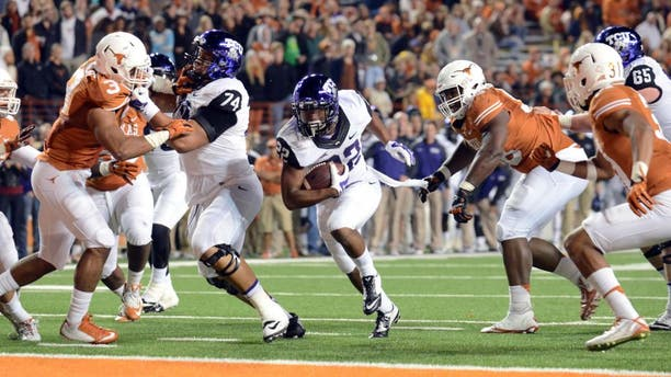 Nov 27, 2014; Austin, TX, USA; TCU Horned Frogs running back Aaron Green (22) scores a touchdown against the Texas Longhorns during the game at Darrell K Royal-Texas Memorial Stadium. Mandatory Credit: Brendan Maloney-USA TODAY Sports