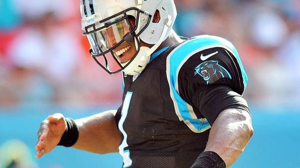 Nov 24, 2013; Miami Gardens, FL, USA; Carolina Panthers quarterback Cam Newton (1) celebrates after scoring a touchdown during the second half against the Miami Dolphins at Sun Life Stadium. The Panthers won 20-16. Mandatory Credit: Steve Mitchell-USA TODAY Sports