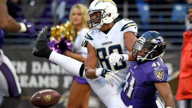 Baltimore Ravens cornerback Anthony Levine (41) breaks up a pass attempt to San Diego Chargers wide receiver Malcom Floyd in the end zone in the second half of an NFL football game, Sunday, Nov. 30, 2014, in Baltimore. Levine received a pass interference call on the play. San Diego won 34-33. (AP Photo/Nick Wass)