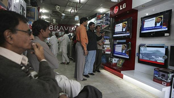 Dec. 2: People watch Wikileaks memos at an electronic shop in Karachi, Pakistan.