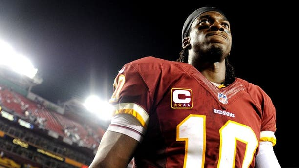 LANDOVER, MD - SEPTEMBER 09: Quarterback Robert Griffin III #10 of the Washington Redskins walks off the field after losing to the Philadelphia Eagles at FedExField on September 9, 2013 in Landover, Maryland. The Philadelphia Eagles won, 33-27. (Photo by Patrick Smith/Getty Images)