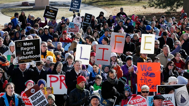 Jan. 22, 2013: Abortion opponents rally at the steps of the Kansas Statehouse in Topeka, Kan.