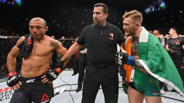 LAS VEGAS, NV - DECEMBER 12: Jose Aldo of Brazil (left) and Conor McGregor of Ireland (right) await the final decision in their UFC featherweight championship bout during the UFC 194 event inside MGM Grand Garden Arena on December 12, 2015 in Las Vegas, Nevada. (Photo by Josh Hedges/Zuffa LLC/Zuffa LLC via Getty Images)