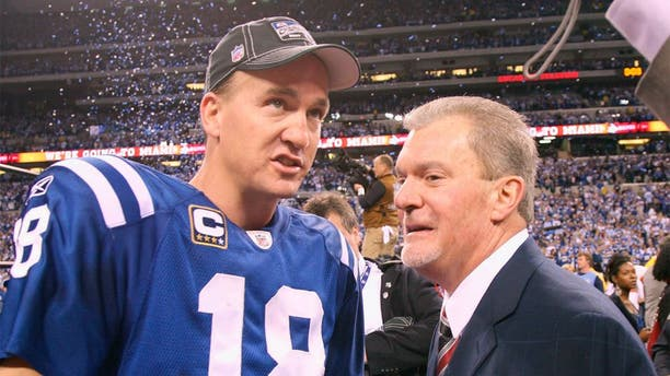 INDIANAPOLIS - JANUARY 24: Quarterback Peyton Manning #18 of the Indianapolis Colts celebrates the victory with owner Jim Irsay when the Indianapolis Colts host the New York Jets in the AFC Championship Game at Lucas Oil Stadium on January 24, 2010 in Indianapolis, Indiana. Colts beat the Jets, 30-17, to advance tot he Super Bowl. (Photo by Al Pereira/Getty Images)