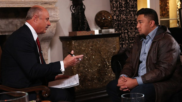 """In this Jan. 24, 2013, photo provided by CBS Television Distribution/Peteski Productions, talk show host Dr. Phil McGraw, left, interviews Ronaiah Tuiasosopo during taping for the """"Dr. Phil Show"""" in Los Angeles."""