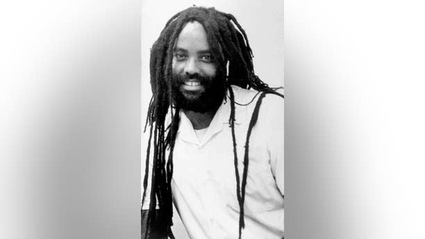 FILE--This undated file photo shows convicted police killer Mumia Abu-Jamal. Goddard College, a liberal arts college in Plainfield, Vt., with 600 students, said  on its website Tuesday, Sept. 30, 2014, that Mumia Abu-Jamal's recorded remarks will be played Sunday at a commencement, along with a video about him. (AP Photo/Jennifer E. Beach, File)