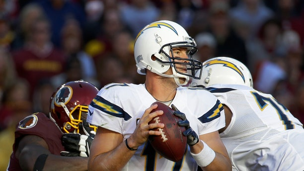 San Diego Chargers quarterback Philip Rivers looks for an open man to pass during the second half of a NFL football game against Washington Redskins in Landover, Md., Sunday, Nov. 3, 2013. (AP Photo/Alex Brandon)