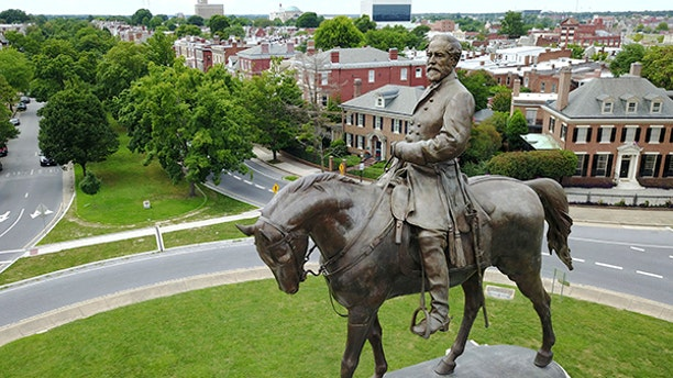 This Tuesday June 27, 2017, photo shows the statue of Confederate Gen. Robert E. Lee that stands in the middle of a traffic circle on Monument Avenue in Richmond, Va. As cities across the United States are removing Confederate statues and other symbols, dispensing with what some see as offensive artifacts of a shameful past marked by racism and slavery, Richmond is taking a go-slow approach. (AP Photo/Steve Helber)