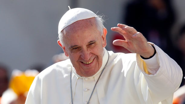 FILE - In this Sept. 18, 2013 file photo, Pope Francis waves to faithful as he arrives for his weekly general audience in St. Peter's Square at the Vatican. Pope Francis convenes his parallel cabinet on Tuesday, Oct. 1, 2013, for a first round of talks on reforming the Catholic Church, bringing eight cardinals from around the globe together in a novel initiative to get local church leaders involved in helping make decisions for the 1.2-billion strong universal Catholic Church. (AP Photo/Riccardo De Luca, File)