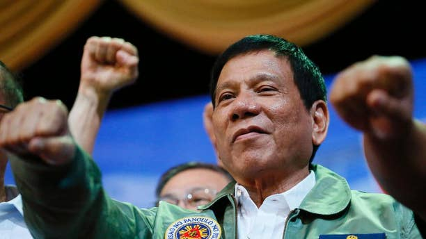 FILE - In this Tuesday, Sept. 13, 2016, file photo, Philippine President Rodrigo Duterte poses with a fist bump during the anniversary of the 250th Presidential Airlift Wing at the Philippine Air Force headquarters in Pasay city, southeast of Manila, Philippines. Impassioned speeches by Duterte about the United States, the European Union and the United Nations have repeatedly led his government to issue clarifications, though he has been on the job less than three months. (AP Photo/Bullit Marquez, File)