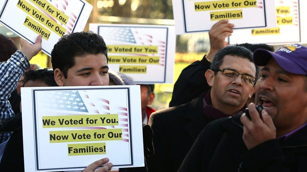 WASHINGTON, DC - NOVEMBER 08:  Latinos and immigrants participate in a rally on immigration reform in front of the White House on November 8, 2012 in Washington, DC. Immigrant rights organizations called on President Barack Obama to fulfill his promise of passing comprehensive immigration reform.  (Photo by Mark Wilson/Getty Images)