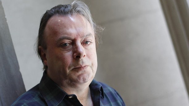 June 7, 2010: Journalist and author Christopher Hitchens poses for a portrait outside his hotel in New York.
