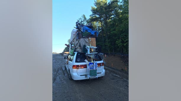 The van was pulled over Wednesday on Interstate 93 with several items -- including a bike and furniture pieces -- attached, police said. (New Hampshire Police Department)