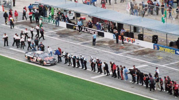 DAYTONA BEACH, FL - FEBRUARY 15: Dale Earnhardt Sr. (April 29, 1951 - February 18, 2001) driver of the #3 GM Goodwrench Chevrolet celebrates with every crew member of every team on pit road after winning the 1998 NASCAR Winston Cup Daytona 500 at the Daytona International Speedway on February 15, 1998 in Daytona Beach, Florida. (Photo by ISC Archives via Getty Images)
