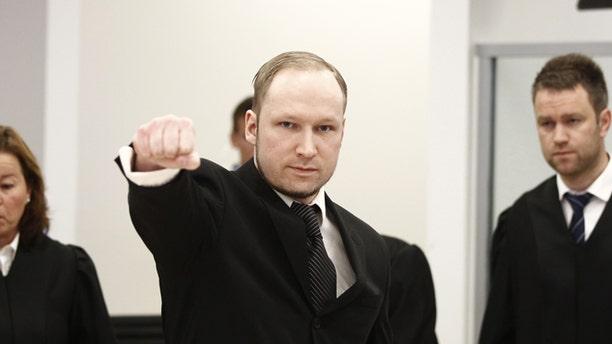 April 18, 2012: Accused Norwegian Anders Behring Breivik gestures between his defence team Vibeke Hein Baera, left, and Odd Ivar Groen, at the courtroom, in Oslo, Norway.