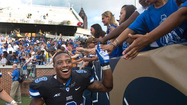 Duke running back Josh Snead (9) celebrates with fans after defeating Georgia Tech 31-25 in an NCAA college football game Saturday, Oct. 11, 2014, in Atlanta.  (AP Photo/John Bazemore)