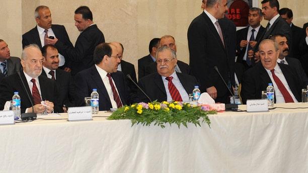 Nov. 8, 2010: leaders of Iraq's main political blocs, front row, from left to right: former Iraqi Prime Minister Ibrahim Jafari, Iraqi Prime Minister Nouri al-Maliki, Iraqi President Jalal Talabani and former Iraqi Prime Minister Ayad Allawi, are seen during their meeting in Irbil, Iraq.