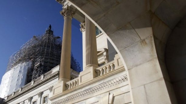 A general view of the U.S. Capitol dome can be seen to the carriage entrance to the U.S. Senate in Washington December 11, 2014. (REUTERS/Jonathan Ernst)