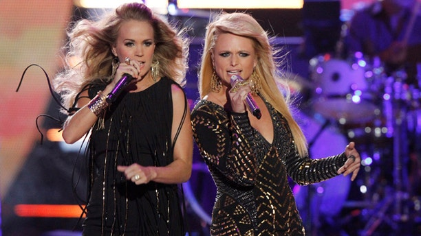June 4, 2014: Carrie Underwood, left, and Miranda Lambert perform on stage at the CMT Music Awards at Bridgestone Arena in Nashville, Tenn. (Photo by Wade Payne/Invision/AP)