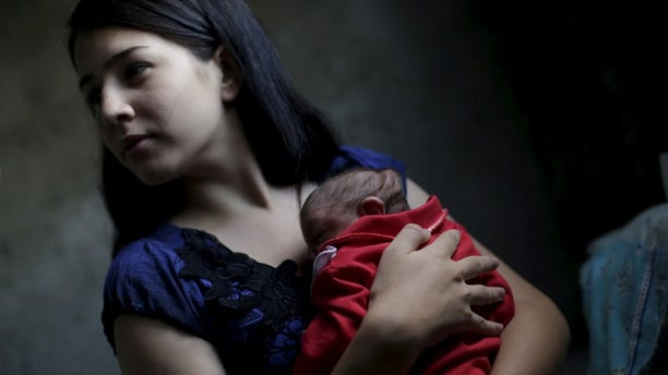 The Wider Image: Zika: Single mothers