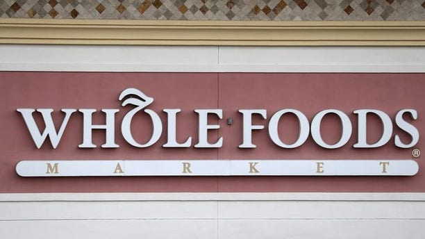 A Whole Foods Market store logo is pictured on a building in Boca Raton, Florida