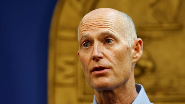 Florida Gov. Rick Scott speaks at a press conference about the Zika virus in Doral