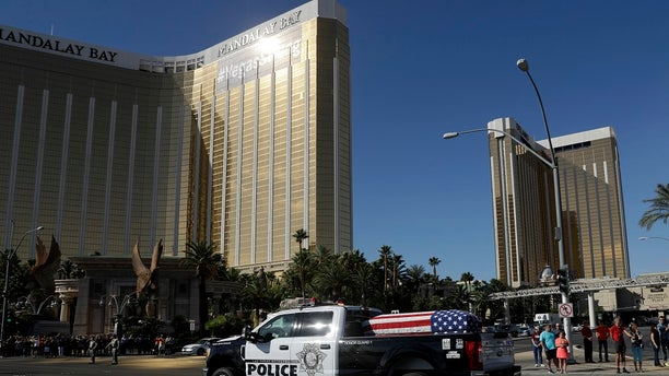 The funeral procession for Las Vegas police officer Charleston Hartfield passed by the Mandalay Bay hotel on the Las Vegas strip.