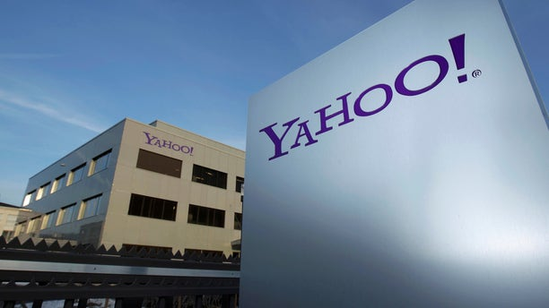 A Yahoo logo is pictured in front of a building in Rolle, 19 miles east of Geneva, December 12, 2012. ( REUTERS/Denis Balibouse/File photo)