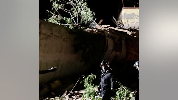 Rescuers and others stand near the site of a fatal train derailment close to the northern city of Thessaloniki, Greece on Sunday, May 14, 2017. The train was traveling on the Athens-Thessaloniki route when it went off the rails near the station at the village of Adendro, 40 kilometers (25 miles) west of Thessaloniki Saturday night. (AP Photo/Giannis Papanikos)