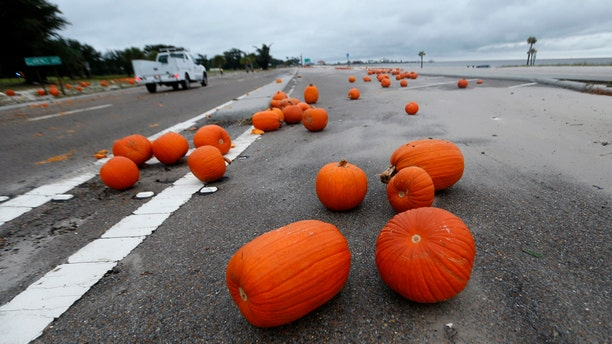 Pumpkins strewn around Highway 90 along the Gulf of Mexico in Pass Christian, Miss., in the aftermath of Hurricane Nate.