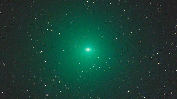 Comet 252P/LINEAR glows a vivid green from fluorescing gas in this composite photo taken from Namibia on March 18, 2016, with a specialized telescope 12 inches in aperture. (Gerald Rhemann / www.astrostudio.at - See more at: http://www.skyandtelescope.com/press-releases/how-to-spot-comet-252p-linear/#sthash.GgGlriwX.dpuf)