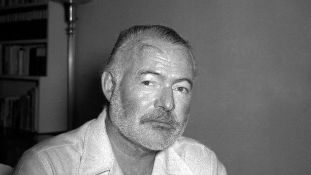 In this Aug. 21, 1950 file photo, novelist Ernest Hemingway appears at his country home in San Francisco de Paula near Havana, Cuba.
